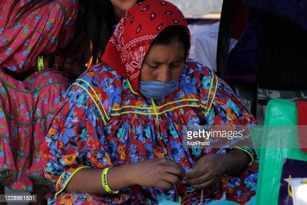 Rarámuri women allegedly in support of the demonstration of the National Anti-AMLO Front in the Zócalo of Mexico City while they make handicrafts, to...