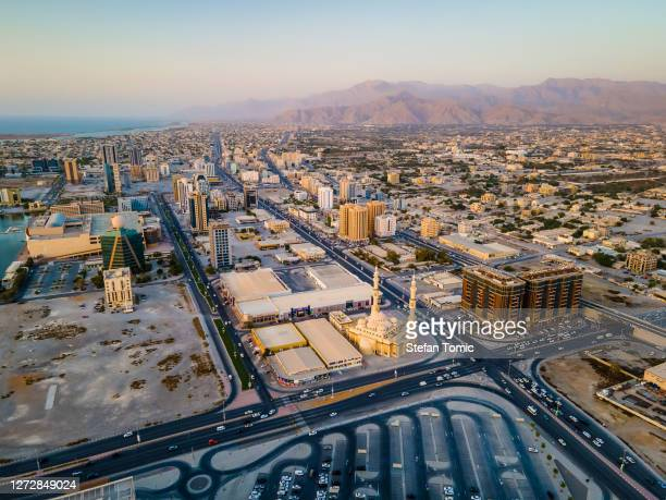 ras al khaimah city urban are with characteristic midle easter architecture aerial view - ras al khaimah stock pictures, royalty-free photos & images