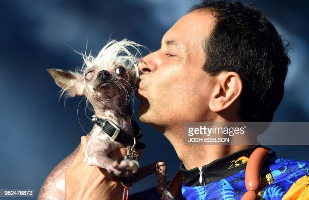Rascal Deux a Chinese Crested gets a kiss from owner Dane Andrew during The World's Ugliest Dog Competition in Petaluma north of San Francisco...