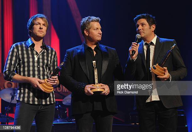 Rascal Flatts Grand Ole Opry Induction Joe Don Rooney Gary LeVox and Jay DeMarcus at The Grand Ole Opry on October 8 2011 in Nashville Tennessee