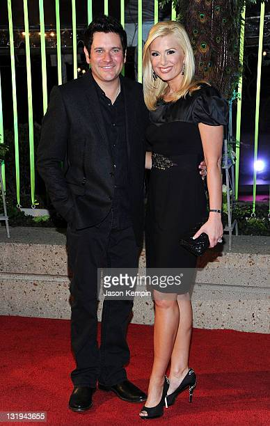 Rascal Flatts' Jay DeMarcus and wife Allison DeMarcus attends the 59th Annual BMI Country Awards on November 8 2011 in Nashville Tennessee