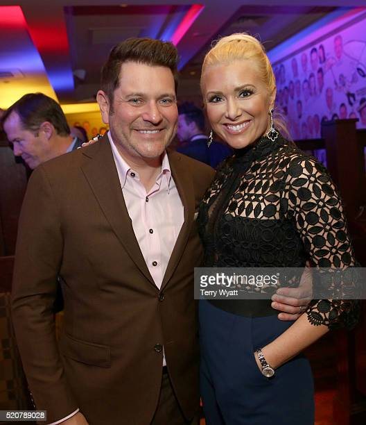 Rascal Flatts member Jay DeMarcus and wife Allison Alderson pose during the Waiting for Wishes Celebrity Waiters Dinner on April 12 2016 in Nashville...