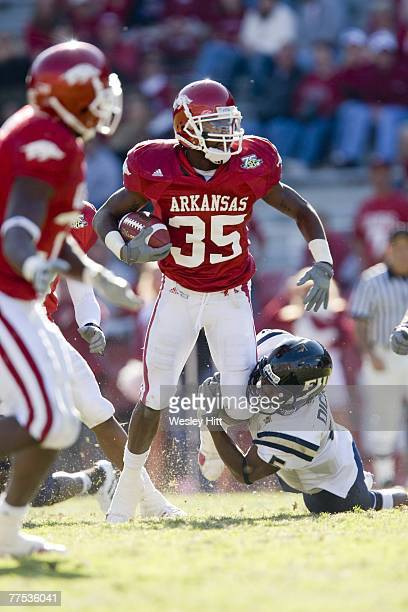 Rashaad Johnson of the Arkansas Razorbacks is tackled after intercepting a pass against the Florida International Golden Panthers at Donald W...