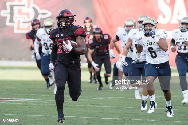SDSU Rashaad Penny breaks a 61 yard run for a touchdown during the college football game between UC Davis Aggies and San Diego State University...