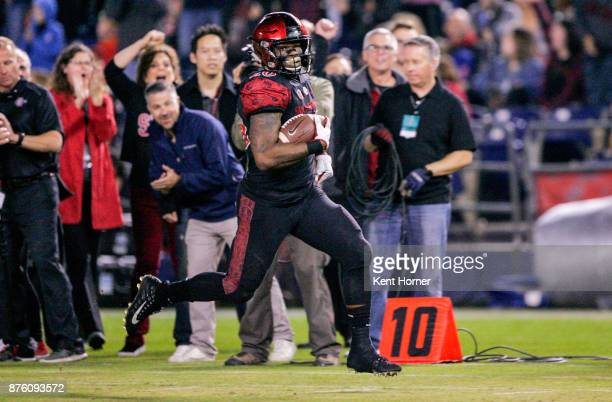 Rashaad Penny of San Diego State returns a punt 70 yards for a touchdown in the first half against Nevada at Qualcomm Stadium on November 18, 2017 in...