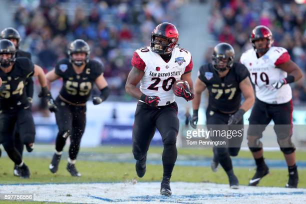 Rashaad Penny of the San Diego State Aztecs scores a touchdown against the Army Black Knights in the Lockheed Martin Armed Forces Bowl at Amon G...