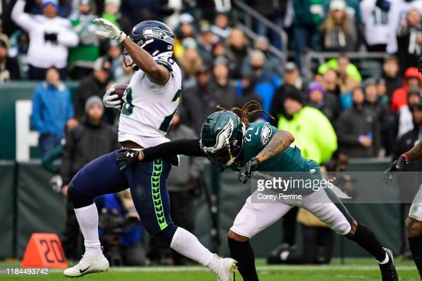 Rashaad Penny of the Seattle Seahawks beats out Ronald Darby of the Philadelphia Eagles en route to a touchdown during the fourth quarter at Lincoln...