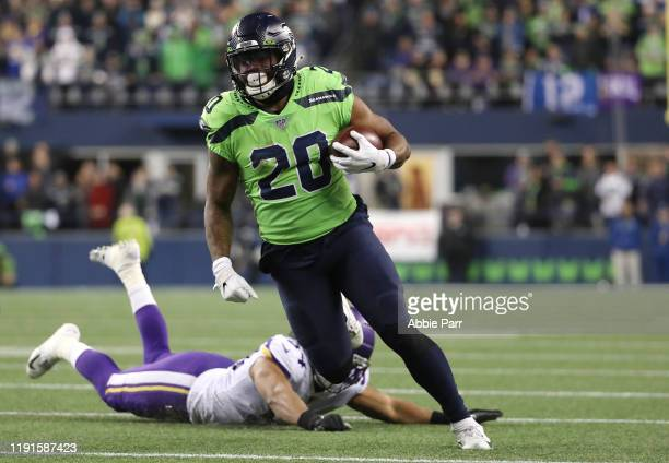 Rashaad Penny of the Seattle Seahawks breaks a tackle against Eric Kendricks of the Minnesota Vikings in the fourth quarter during their game at...