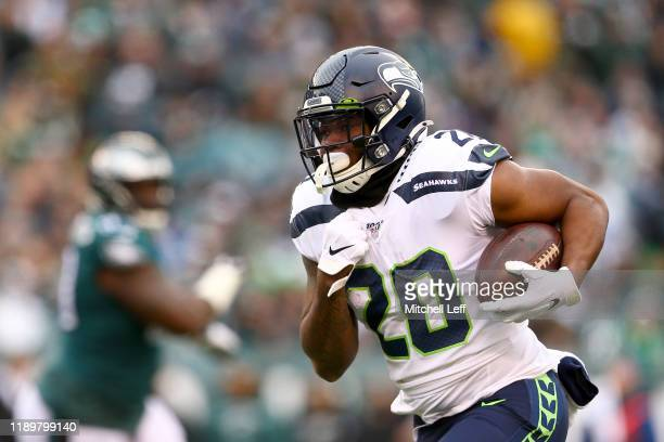 Rashaad Penny of the Seattle Seahawks carries the ball against the Philadelphia Eagles in the first half at Lincoln Financial Field on November 24,...