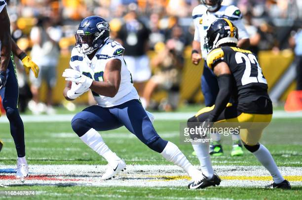 Rashaad Penny of the Seattle Seahawks carries the ball in front of Steven Nelson of the Pittsburgh Steelers during the first quarter at Heinz Field...