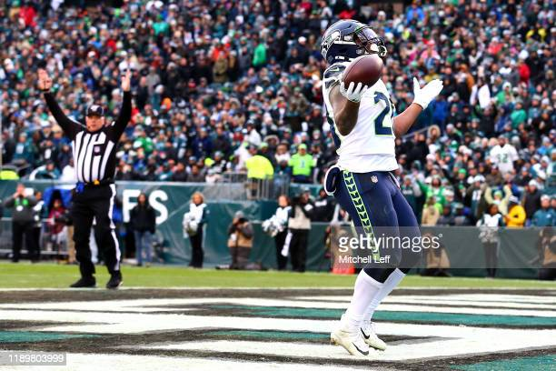 Rashaad Penny of the Seattle Seahawks celebrates after rushing for a fourth quarter touchdown against the Philadelphia Eagles at Lincoln Financial...