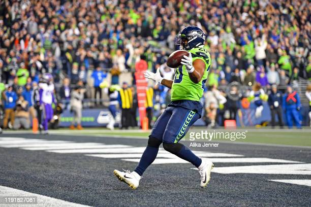 Rashaad Penny of the Seattle Seahawks celebrates after scoring a touchdown during the game against the Minnesota Vikings at CenturyLink Field on...