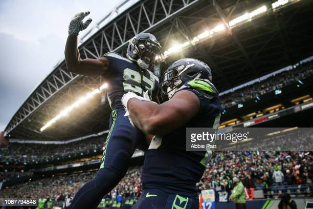 Rashaad Penny of the Seattle Seahawks celebrates his touchdown with teammate David Moore in the third quarter against the San Francisco 49ers at...