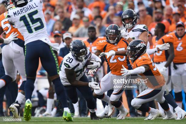 Rashaad Penny of the Seattle Seahawks is tackled by Brandon Marshall of the Denver Broncos during the third quarter The Denver Broncos hosted the...