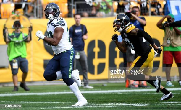 Rashaad Penny of the Seattle Seahawks runs for a 37-yard touchdown in the third quarter during the game against the Pittsburgh Steelers at Heinz...