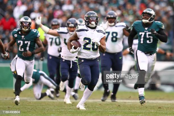 Rashaad Penny of the Seattle Seahawks runs for a touchdown past Malcolm Jenkins and Vinny Curry of the Philadelphia Eagles in the second half at...