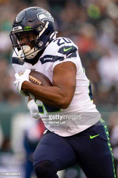 Rashaad Penny of the Seattle Seahawks runs the ball against the Philadelphia Eagles at Lincoln Financial Field on November 24, 2019 in Philadelphia,...