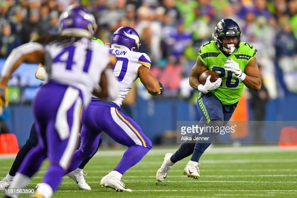 Rashaad Penny of the Seattle Seahawks runs the ball during the first quarter against the Minnesota Vikings at CenturyLink Field on December 02, 2019...