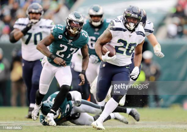 Rashaad Penny of the Seattle Seahawks runs the ball for touchdown in the fourth quarter as Ronald Darby Jenkins of the Philadelphia Eagles defends at...