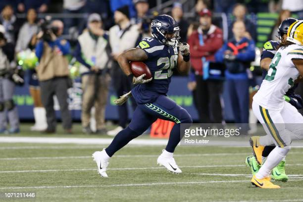 Rashaad Penny of the Seattle Seahawks runs with the ball during the game against the Green Bay Packers at CenturyLink Field on November 15, 2018 in...