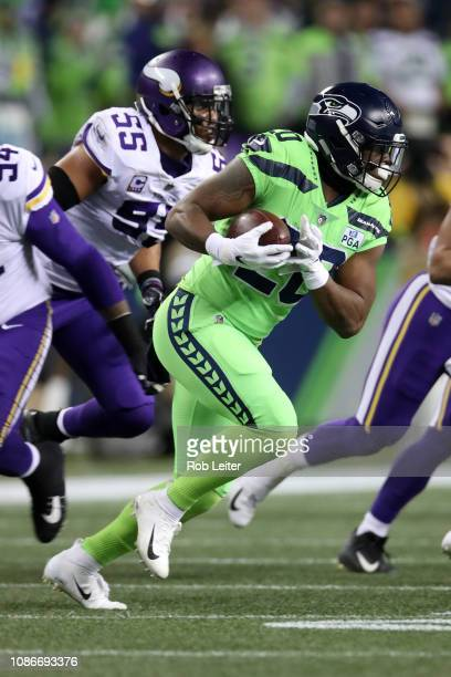 Rashaad Penny of the Seattle Seahawks runs with the ball during the game against the Minnesota Vikings at CenturyLink Field on December 10, 2018 in...