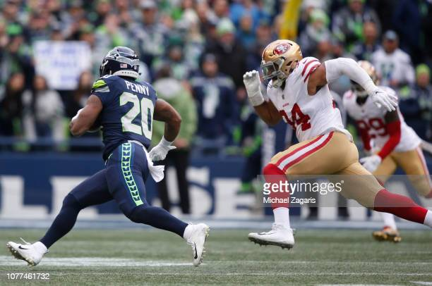Rashaad Penny of the Seattle Seahawks rushes as Solomon Thomas of the San Francisco 49ers chases him during the game at CenturyLink Field on December...