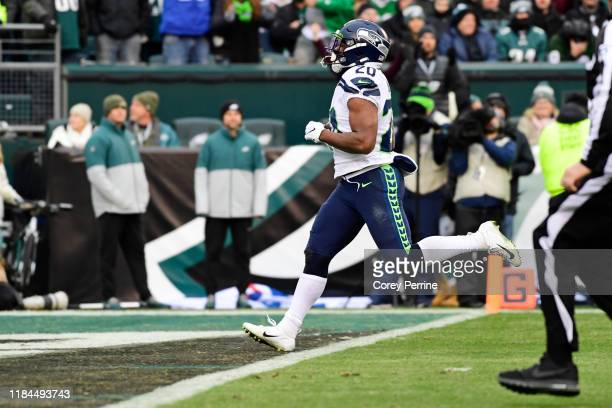 Rashaad Penny of the Seattle Seahawks rushes for a touchdown during the fourth quarter at Lincoln Financial Field on November 24, 2019 in...