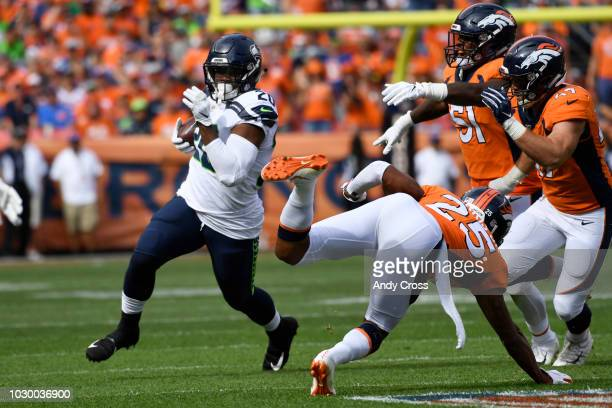 Rashaad Penny of the Seattle Seahawks rushes with the ball during the second quarter against the Denver Broncos The Denver Broncos hosted the Seattle...