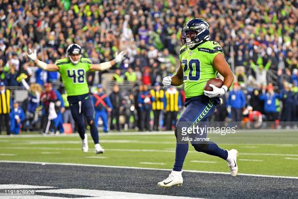Rashaad Penny of the Seattle Seahawks scores a touchdown during the game against the Minnesota Vikings at CenturyLink Field on December 02, 2019 in...