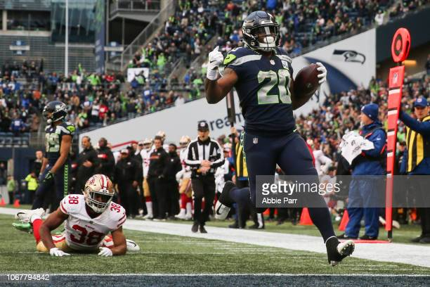 Rashaad Penny of the Seattle Seahawks scores a touchdown in the third quarter against the San Francisco 49ers at CenturyLink Field on December 2,...