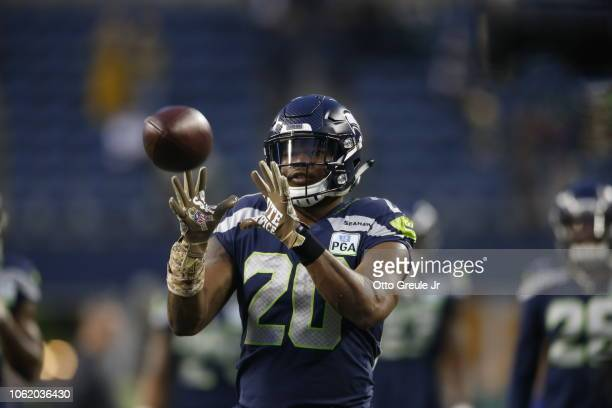 Rashaad Penny of the Seattle Seahawks warms up before the game against the Green Bay Packers at CenturyLink Field on November 15, 2018 in Seattle,...