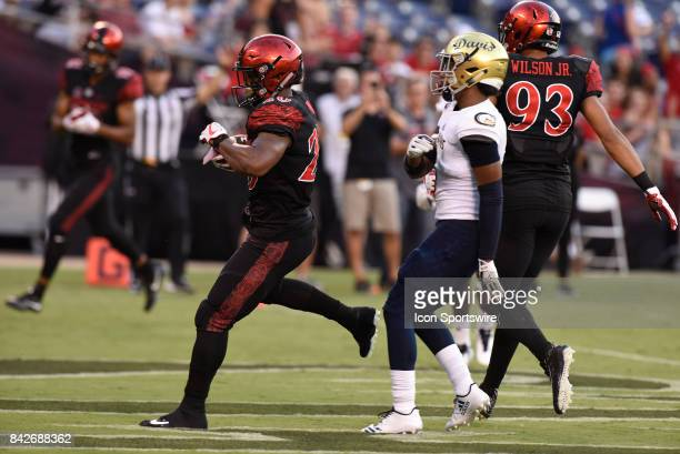 SDSU Rashaad Penny score his second rushing touchdown during the college football game between UC Davis Aggies and San Diego State University Aztecs...
