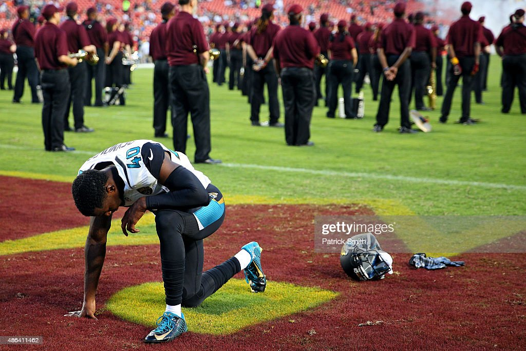 Rashaad Reynolds #40 of the Jacksonville Jaguars has a moment to himself before playing the Washington Redskins at FedExField on September 3, 2015 in Landover, Maryland. The Jacksonville Jaguars won, 17-16.