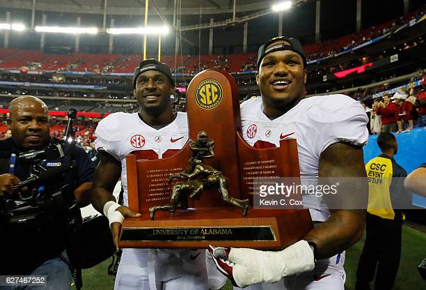 Rashaan Evans and Da'Shawn Hand of the Alabama Crimson Tide celebrate their 54 to 16 win over the Florida Gators during the SEC Championship game at...