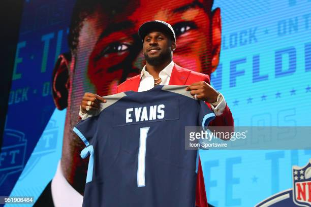 Rashaan Evans holds a jersey and takes photos after being chosen by the Tennessee Titans with the 22nd pick during the first round at the 2018 NFL...