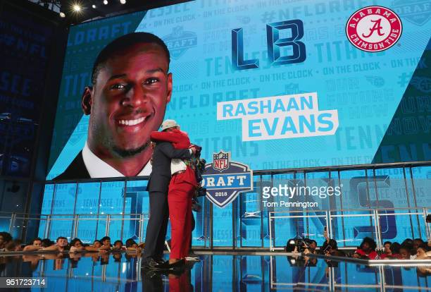 Rashaan Evans of Alabama hugs NFL Commissioner Roger Goodell after being picked overall by the Tennessee Titans during the first round of the 2018...