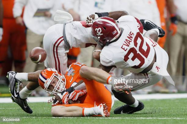 Rashaan Evans of the Alabama Crimson Tide breaks up a pass intended for Hunter Renfrow of the Clemson Tigers in the first quarter of the AllState...