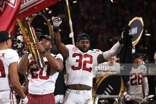 Rashaan Evans of the Alabama Crimson Tide celebrates with his team after defeating the Georgia Bulldogs in overtime to win the CFP National...
