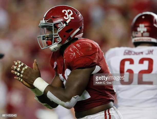 Rashaan Evans of the Alabama Crimson Tide reacts after sacking Cole Kelley of the Arkansas Razorbacks at BryantDenny Stadium on October 14 2017 in...
