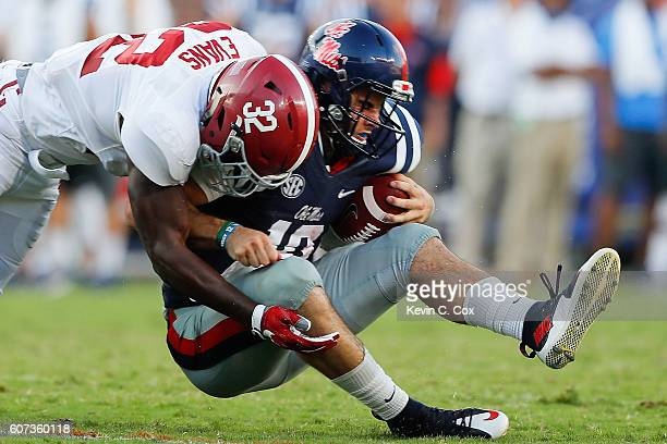 Rashaan Evans of the Alabama Crimson Tide tackles Chad Kelly of the Mississippi Rebels at VaughtHemingway Stadium on September 17 2016 in Oxford...