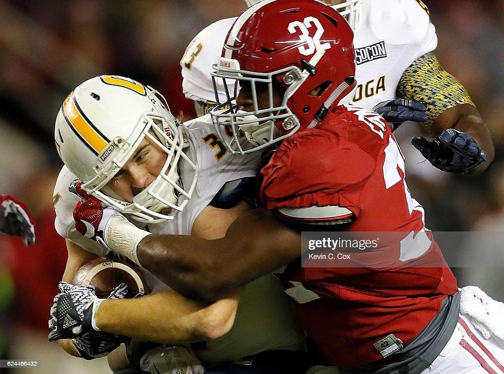 Rashaan Evans #32 of the Alabama Crimson Tide tackles Derrick Craine #34 of the Chattanooga Mocs at Bryant-Denny Stadium on November 19, 2016 in Tuscaloosa, Alabama.