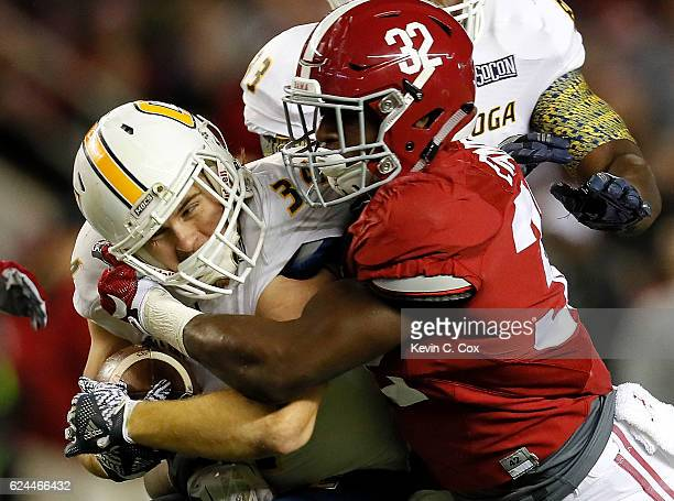 Rashaan Evans of the Alabama Crimson Tide tackles Derrick Craine of the Chattanooga Mocs at BryantDenny Stadium on November 19 2016 in Tuscaloosa...