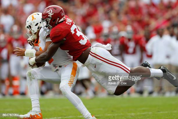 Rashaan Evans of the Alabama Crimson Tide tackles Jarrett Guarantano of the Tennessee Volunteers at BryantDenny Stadium on October 21 2017 in...