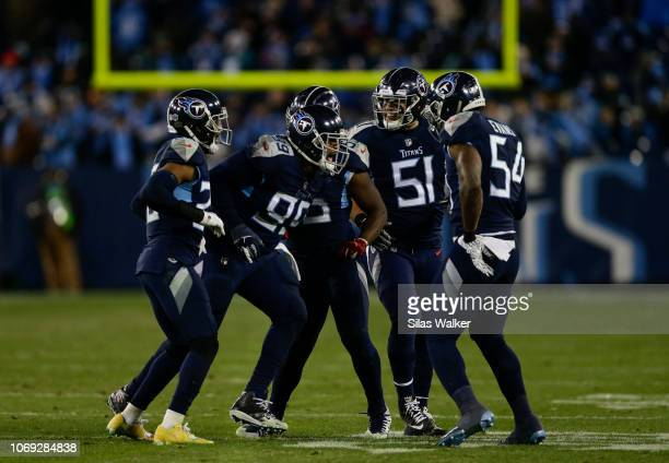 Rashaan Evans of the Tennessee Titans and team members celebrate a tackle against the Jacksonville Jaguars during the fourth quarter at Nissan...