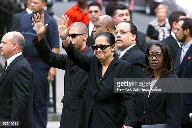 Rashad and Diane Haughton Aaliyah's brother and mother salute crowd of mourning fans as they arrive at St Ignatius Loyola Roman Catholic Church on E...