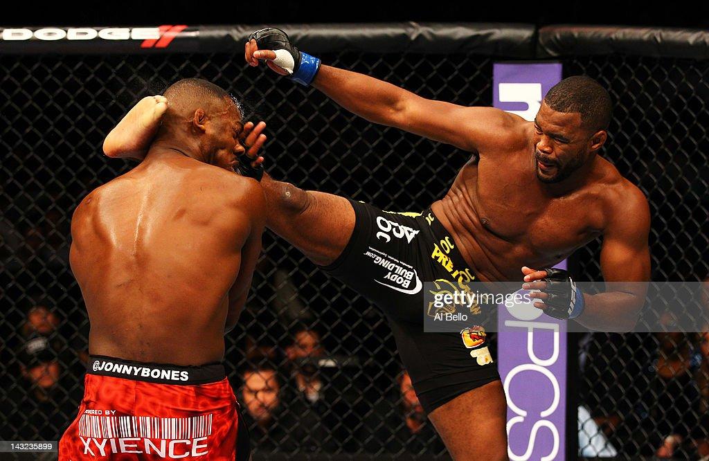 Rashad Evans (R) kicks Jon Jones during their light heavyweight title bout for UFC 145 at Philips Arena on April 21, 2012 in Atlanta, Georgia.