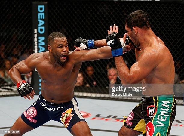 Rashad Evans punches Antonio Rogerio Nogueira during their light heavyweight fight at UFC 156 on February 2 2013 at the Mandalay Bay Events Center in...