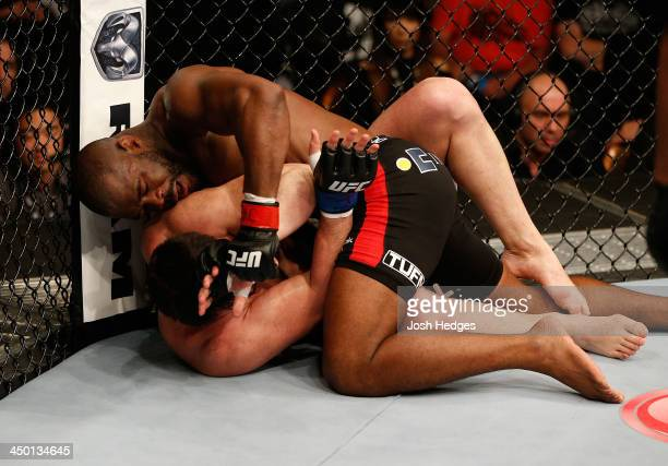Rashad Evans punches Chael Sonnen in their light heavyweight bout during the UFC 167 event inside the MGM Grand Garden Arena on November 16 2013 in...