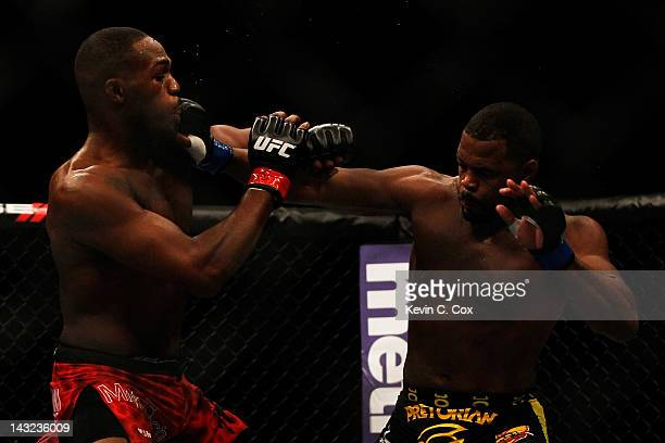 Rashad Evans punches Jon Jones during their light heavyweight title bout for UFC 145 at Philips Arena on April 21 2012 in Atlanta Georgia