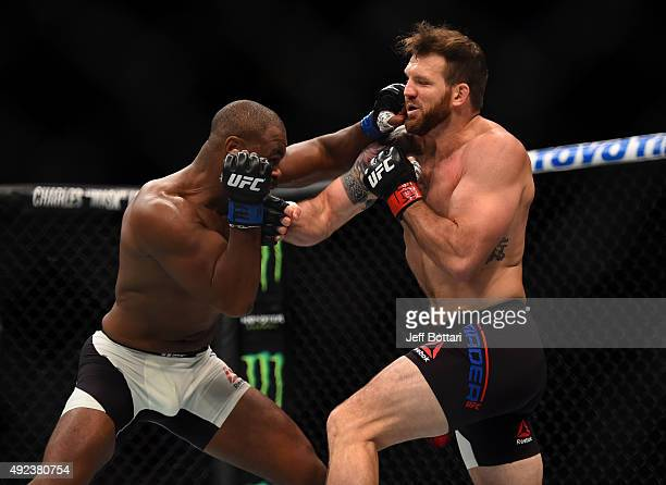 Rashad Evans punches Ryan Bader in their light heavyweight bout during the UFC 192 event at the Toyota Center on October 3 2015 in Houston Texas
